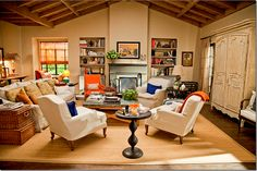 """the living room from the movie """"It's Complicated."""" I like all the seating options and the cabinet that hides the TV."""
