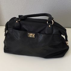 Black handbag. Black slouchy bag with gold-tone hardware and black lining. Inside has a middle zip pocket, a wall zip pocket and compartment wall pockets. Bag also has the capability to be a cross body, but did not & does not come with detachable shoulder straps. Two outer zips have a letter 'A' on them. No brand. Overall good condition, some wear on interior zips,  lining and handles. Scratches/scuffs on hardware (might be hard to see in pics, zoom in or ask for more pics). Final sale. Sold…