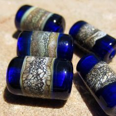 Rich Transparent Cobalt Blue Tubes with silvered ivory band $12.00, via Etsy.