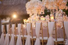 Chairs.. simple & gorgeous - pink gold blush. Perfect example of stunning and elegant. With the perfect- less is more effect.It all depends on the tone of your event. This does not have to have the large flowers, smaller ones would change the tone. Bridal visions2veils