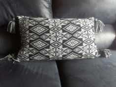 Fair Isle cushion made using acrylic yarn.