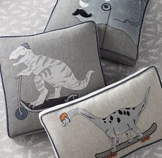 RH Baby & Child's Appliquéd Dinosaur Pillow Cover & Insert:Dig these dinos, from the Triceratops with mustache and monocle to the freewheeling T. rex and Brachiosaurus. They're appliquéd on classic herringbone and tweed, and framed with contrast piping.