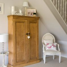 Like this idea for under the stairs. Place a traditional-style cabinet under your hallway staircase for fab storage. Antique-pine is perfect for an elegant French feel. Use for coats, boots and shoes and finish off with photos and accessories on top.