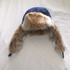 Navy Blue Faux Fur Hat  Bought from target! Only worn once. Snap closure!! Mossimo Supply Co. Accessories Hats