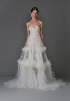 Strapless gown with sheer overlay | Marchesa Spring 2017 | https://www.theknot.com/content/marchesa-wedding-dresses-bridal-fashion-week-spring-2017