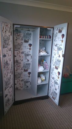 Upcycled wardrobe - repainted, re-treated wood and wallpapered inside, petfect baby/kids room addition.
