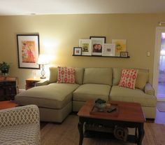 Neutral sofa and paint with pops of persimmon and yellow