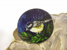 This pin is black with a delicate chickadee and tiny greenery. It is made of wood with all elements painted and coated with varnish. Stocking Stuffers For Women, Made Of Wood, Delicate, Brooch, Hand Painted, Tableware, Artwork, Dinnerware, Work Of Art