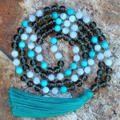 I cant get enough of this custom designed mala! The mix of turquoise, smokey quartz and moonstone is just so pretty! Our client loves to travel so we used turquoise as it is often used for security and protection when on a journey. The smokey quartz and moonstone add an extra layer of grounding and fearlessness. She is ready for her next adventure!  #mymalarae #malarae  #customdesign #malas #malabeads #jewelry #gemstones #crystals #intention #meditation #mantra #boho #mindset