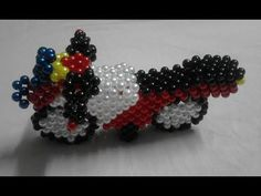how to make a beaded motor bike part - 1 Wire Jewelry, Beaded Jewelry, Brick Stitch Tutorial, Bead Bottle, Cinderella Costume, Beaded Crafts, Paper Flowers Diy, Beaded Animals, Beaded Bags