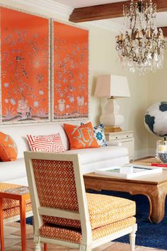 We love mixing orange with white and blue in a living room, it is such a bright energizing color. The color psychology of orange tells us that orange will improve communication and harmony in your space, bringing happiness and energy. Learn how to incorporate orange into your home decor, in your living room, bedroom, kids bedroom, kitchen, dining room, and other spaces. We also share popular combinations like orange and white, orange and blue, orange and gray. Hadley Court Interior Design…