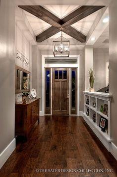 Transitional Entryway with Built-in bookshelf, flush light, Hardwood floors