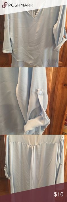 Baby blue blouse Baby blue women's blouse. Can be worn sleeves down or rolled up. Tops Blouses