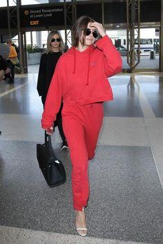 Selena Gomez wearing Jimmy Choo Minnie Sandals, Vetements Hooded Logo-Print Sweatshirt and Vetements Cut-Out Cuffs Track Pants