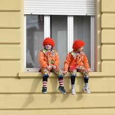 Clowning around on a window ledge-The 144-year-old Carnival of Viareggio in Tuscany is one of Italy's most spectacular street events. Photographer Christian Sinibaldi