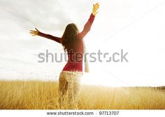 Young girl spreading hands with joy and inspiration facing the sun by Petar Paunchev, via Shutterstock