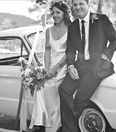 "#regram from @shareenbridal ""Love Annika!! The simplicity of her #shareenbridal dress, the crown, the boots, (!), the car...#authentic #coolbride #labride #satindress #slipdress"""