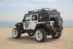 Jeep Wrangler black&white jk full custom lifted white wheels flat top fenders bumper rock guards large cargo basket