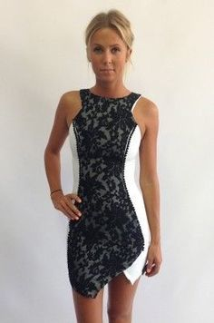 So much to love in this dress. Two tone colour, lace and an asymmetrical hemline