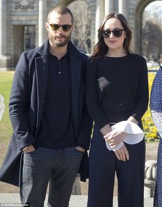 Looking cool: The 34-year-old British star also donned a pair of specs as he posed alongside Dakota