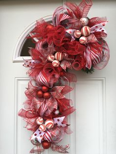 A personal favorite from my Etsy shop https://www.etsy.com/listing/476900818/candy-cane-christmas-wreath-candy-cane