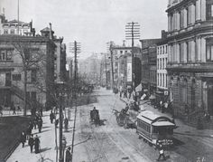 """The intersection at Centre Street and Park Row in 1890. """"The horsecar of the Fourth and Madison Avenue line is on its way uptown to Harlem, having just come from Park Row,"""" states the caption. """"Begun in 1832, it was the first streetcar railway in the world."""" At right are the offices of a popular German-language newspaper called New Yorker Staats-Zeitung"""