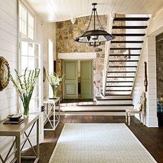 Best New Home/ Modern Touches:  Love the staircase and the color of front door.  And don't forget the stone wall!