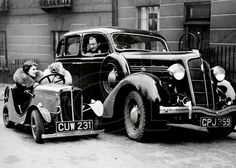 Small cars aren't just a modern day idea, as this great shot shows! And don't the girls look so elegant?