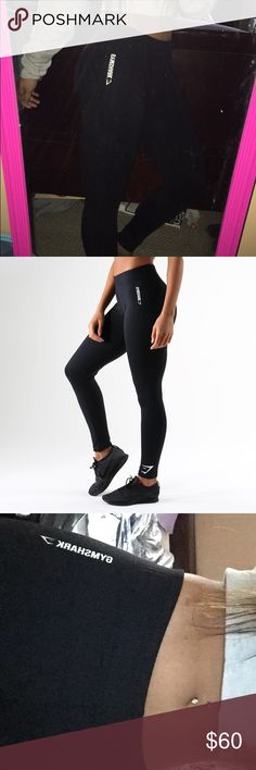 GYMSHARK ARK JERSEY LEGGING Mix between leggings and joggers! Tight fit like leggings but has a stretchable elastic waistband like joggers. Says Gymshark on the side by the hip & has the symbol at the bottom by the ankle. Gymshark Pants Leggings