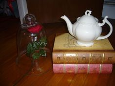 Beauty and the Beast - Large book boxes with teapot as table centerpiece and party decor.  LOVE!