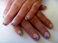 White french gel polish and some hand tiger stripes with glitter