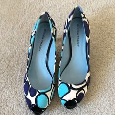 Ellen Tracy bright colored open toed pumps These were worn one time for a wedding.  In excellent condition.   No marks or scuffs.  Navy. Black, Aqua and white.  Wedges are black close to shoe and clear at the bottom. Ellen Tracy Shoes Wedges