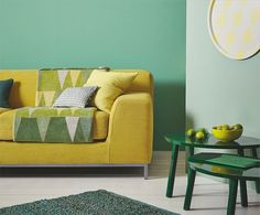 Pretty tones of green bring the outside in, as well as adding a calming, harmonious look. For extra interest team two similar leafy shades together and add pops of colour to the scheme by introducing bright orange and yellow.