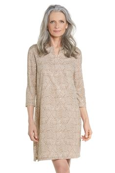 "A perfect balance of casual and sophistication, in our ""best seller"" tunic dress style, this silky soft lightweight dress is a luxury piece with the practical sun blocking UPF 50+ protection you know you can depend on. The hardest part about slipping into this tunic dress will be deciding which places you would like to visit while wearing it!"