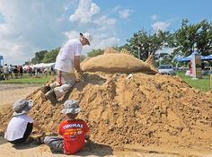Little boys mimic sand sculptor Randy Hofman of Ocean City  at the 44th annual Maryland Seafood Festival and Sandy Point State Park, Saturday.(Laura-Chase McGehee - The Capital) 9/10/11