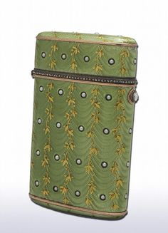 A Faberge jeweled gold and enamel cigarette case, workmaster Henrik Wigstrom. Green enamel set with gold vines, diamonds and seed pearls.