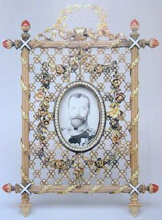 A gold and pearl mesh picture frame containing a washed-out photograph of Tsar Nikolai II. / via: Marie Poutine's Jewels & Royals: Fabergé Trinkets