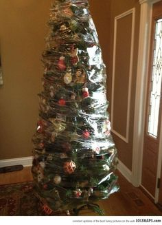 Screw It! This Is How We Took Down Our Fake Christmas Tree This Year...