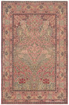 Laver Kirman antique Persian rug, circa 1875 This masterful Persian carpet utilizes the beloved Tree of Life theme and features soft pastel tones, graceful branches, and a flourish of blossoms.