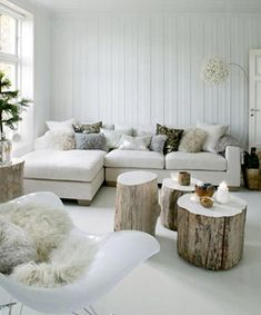 Love those little makeshift wood tables! Fitting and easy side tables.. Could even build off idea-- add internal shelves?