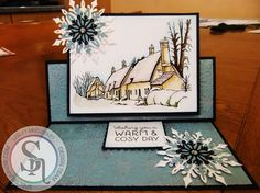 Lesley McCloskey. A Country Life - Home Sweet Home stamp. Stamped onto Watercolour card. Coloured with Spectrum Aquas - Moss, Charcoal, Slate, Desert, Boulder and Aquamarine. Also used Crystal Clear Spectrum Sparkle pen, Matt Black card, Teal Core'dinations, Die'sire Snowflake die, Pebeo Silver gilding wax, A4 snowflake embossing folder - #crafterscompanion #spectrumaqua