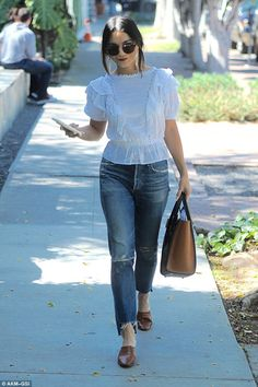 A spring in her step: Vanessa Hudgens showed how to transition your style from winter to s...