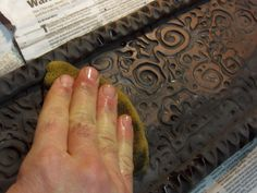 """Applying black underglaze to textured terra cotta and then wiping it off leaves it in the indentations, providing a nice """"antiqued"""" look that also highlights the texture.  These look great without an overglaze."""