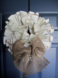 Book Page Wreaths  Wreaths are an interesting use of book pages and would be perfect for any vintage wedding or fun party.