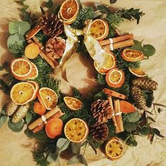 Buy the base of a natural pine wreath, add cinnamon sticks,  pine cones and dried orange slices and voila :) house full of Xmas smell