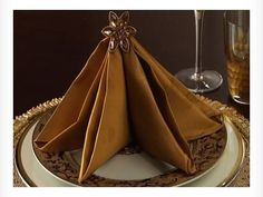 "▶ How to Fold a Christmas Tree Napkin - YouTube  ~  A different ""star"" for each place setting would be cute"