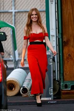 Strutting her stuff: The actress cut a trim figure in the pantsuit, showing off her small ...