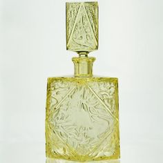 An eye catching citrine glass Deco decanter, the front of the rectangular stopper and bottle high relief moulded and acid. Crystal Perfume Bottles, Vintage Perfume Bottles, Bohemia Glass, Beautiful Perfume, Glass Molds, Blue Bottle, Carnival Glass, Bottle Crafts, Decanter