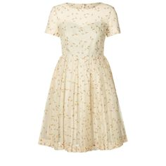 Orla Kiely: Short sleeve dress in Tiny Dragonfly print silk organza. The sleeve and top of bodice is sheer, the dress lined from a sweetheart neckline downwards. Skirt section is full with pleats giving this dress a lovely silhouette. Button feature at back neck with zip to fasten.