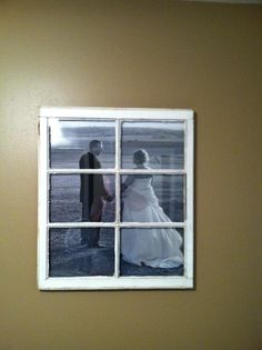 an old window pane and a black and white photo